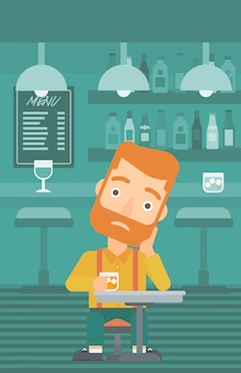 Homem sentado no bar.