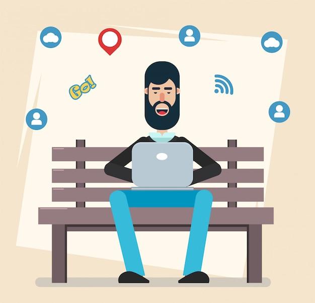 Homem sentado no parque no banco com laptop