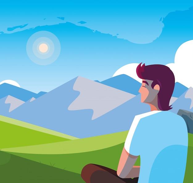 Homem sentado observando a paisagem montanhosa