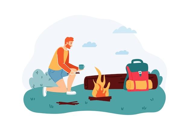Homem sentado perto da fogueira e bebendo uma xícara de chá perto de log.