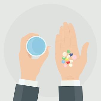 Homem tem comprimidos, comprimidos, cápsulas e um copo de água nas mãos. tomar remédios