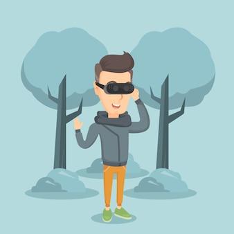 Homem usando fone de realidade virtual no parque.