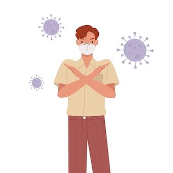Homem vestindo máscara facial. jovem com gesto de braços cruzados. pare o conceito de pandemia.