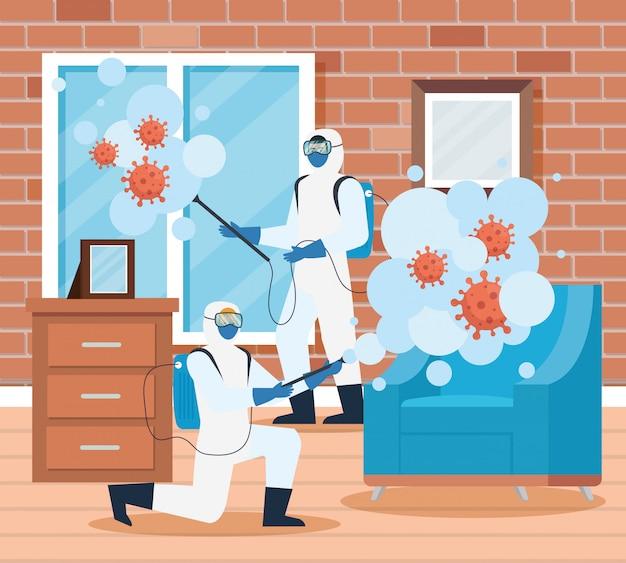 Homens com traje de proteção pulverizando a janela e a cadeira