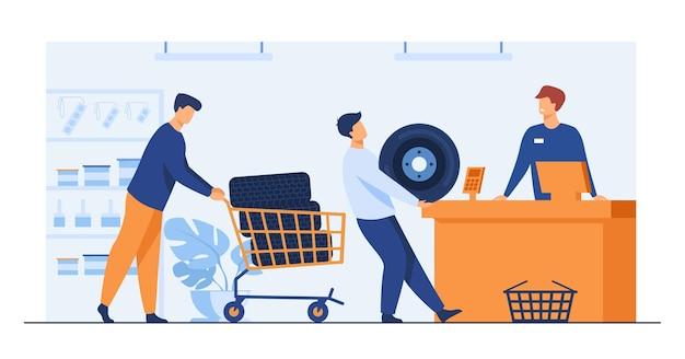 Homens comprando pneus na oficina