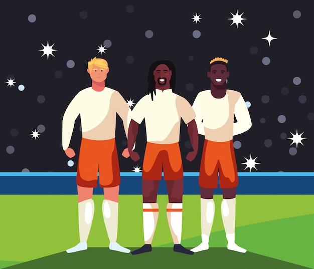 Homens de jogador de futebol em pé no estádio