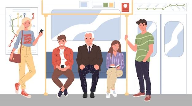 Homens e mulheres em pé no metrô