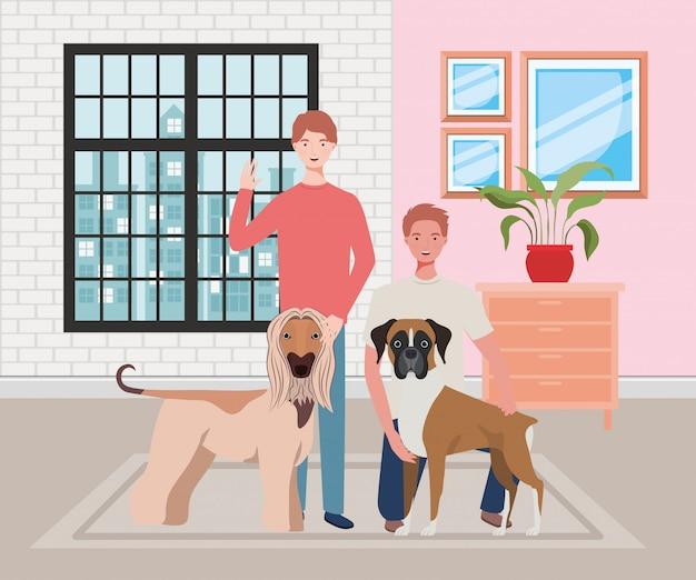Homens jovens com mascotes de cães fofos em casa