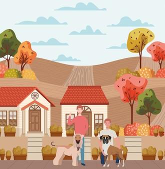 Homens jovens com mascotes de cães fofos na cena da cidade de outono