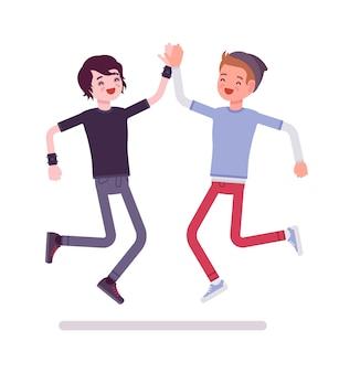 Homens jovens pulando dando mais cinco