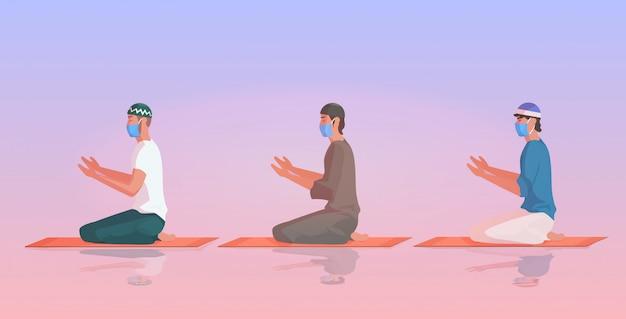 Homens muçulmanos em máscaras orando ramadan kareem mês sagrado religião coronavírus pandemia quarentena
