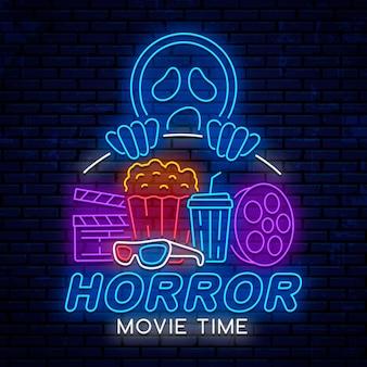 Hora do filme de terror, sinal de néon à noite