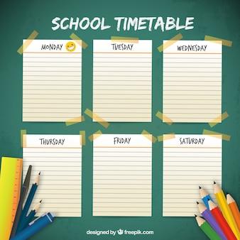 Horário escolar com páginas e materiais de caderno