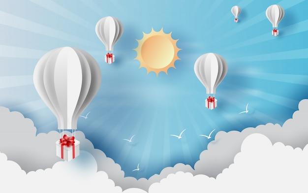Horas de verão pela flutuação do giftbox dos balões.