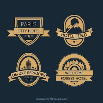 Hotéis planas e dourados emblemas