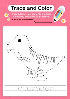 I rastreando a palavra para dinossauros e colorindo a planilha de rastreamento com a palavra iguanodon