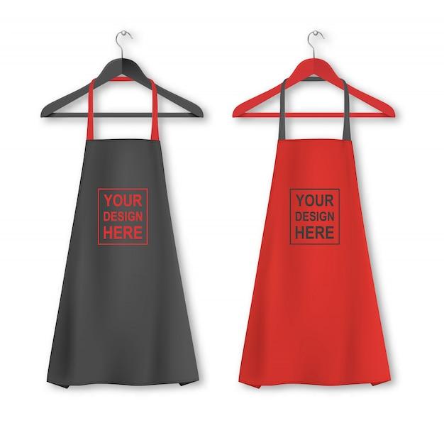 Ícone de avental de cozinha de algodão conjunto com cabides closeup no fundo branco. cores pretas e vermelhas modelo, mock up para branding, publicidade etc. conceito de culinária ou padeiro