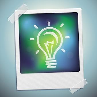 Ícone de lâmpada na moldura polaroid