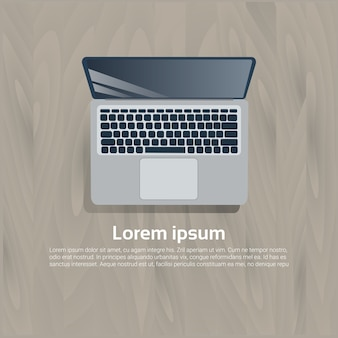 Ícone de vista superior do computador portátil na madeira texturizado modelo de fundo