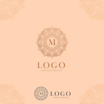 Ícone do logotipo da mandala de flor abstrata da letra m