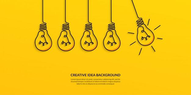Idéia criativa com banner de lâmpada