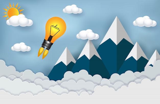 Ideia criativa. lançamento da lâmpada no céu e na montanha