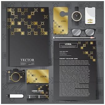 Identidade corporativa definida com artigos de papelaria preto e dourado