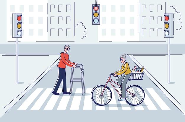 Idosos atravessando a rua, velho andando com bengala e uma senhora andando de bicicleta
