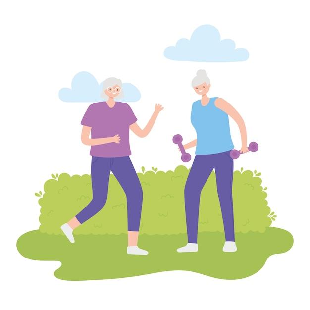 Idosos de atividade, duas mulheres idosas no parque com halteres.