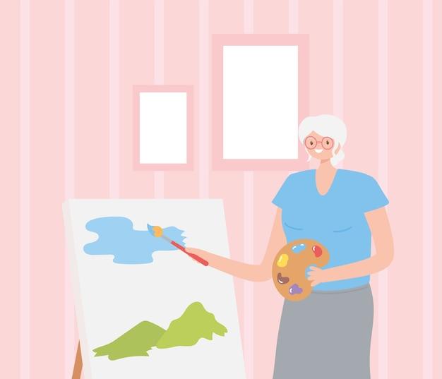 Idosos de atividade, mulher idosa pintando com pincel sobre tela.