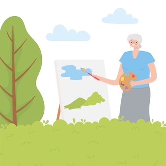 Idosos em atividade, mulher mais velha pintando com pincel sobre tela no parque.