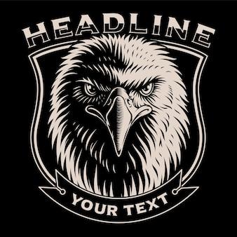 Ilustração a preto e branco da cabeça de águia no fundo escuro.