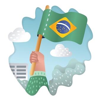 Ilustração da mão segurando e levantando a bandeira nacional do brasil. fãs, conceito patriótico em fundo ao ar livre.