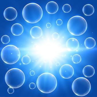 Ilustração de bolhas de água brilhando em azul