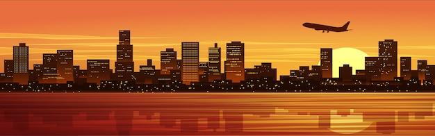 Ilustração de cidade ao pôr do sol com avião