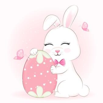 Ilustração de desenho animado de coelhinho fofo e ovo de páscoa