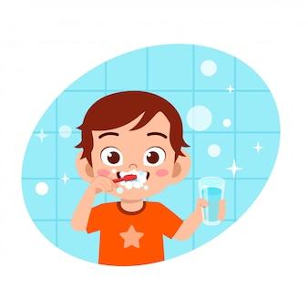 Ilustração de menino bonito feliz escova dentes limpos
