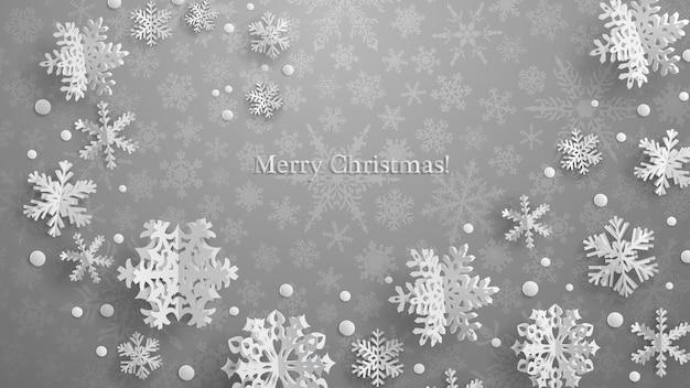 Ilustração de natal com flocos de neve de papel tridimensional branco em fundo cinza