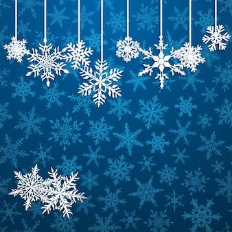 Ilustração de natal com flocos de neve pendurados brancos sobre fundo azul