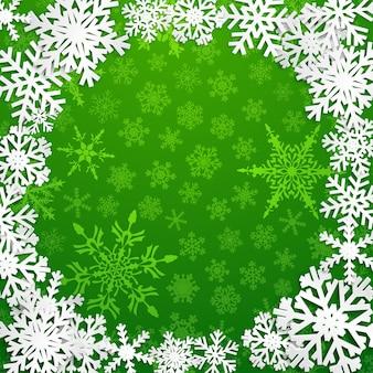 Ilustração de natal com moldura circular de flocos de neve brancos sobre fundo verde