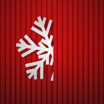 Ilustração de natal com um grande floco de neve branco que se projeta do corte em um fundo listrado em cores vermelhas