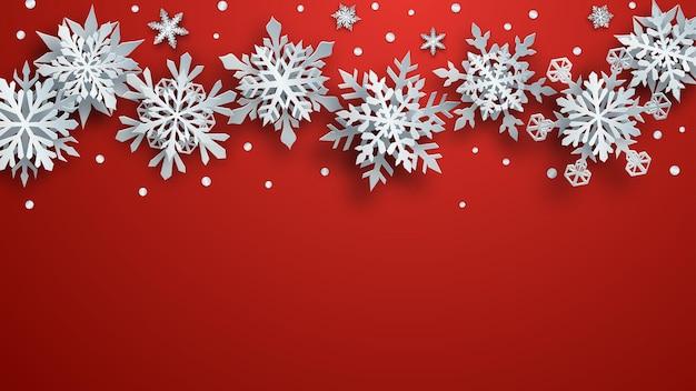 Ilustração de natal de flocos de neve de papel branco complexo com sombras suaves sobre fundo vermelho