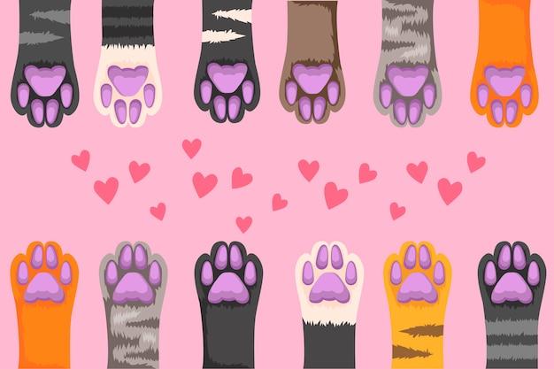 Ilustração de patas de gato multi-coloridas em um fundo rosa.