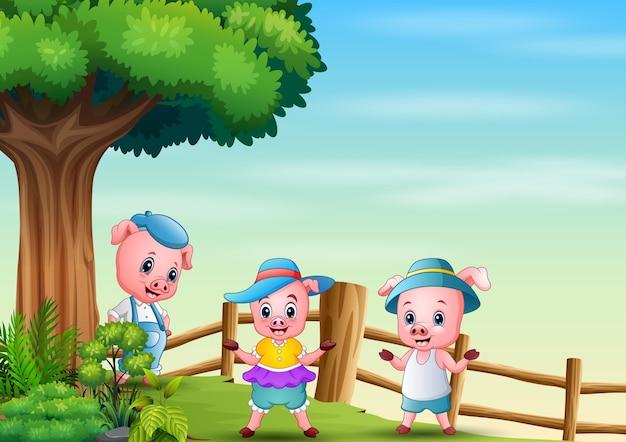 Ilustração de três porquinhos debaixo de uma grande árvore