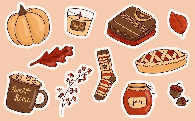 Ilustração de um conjunto de adesivos de ícones do doodle sobre o tema outono.