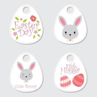 Ilustração do desenho animado coelhinho bonito e decorações adequadas para etiqueta de presente da páscoa feliz