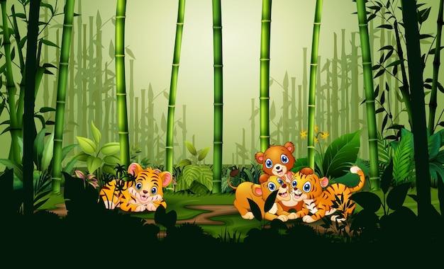 Ilustração dos desenhos animados de muitos animais brincando na floresta de bambu