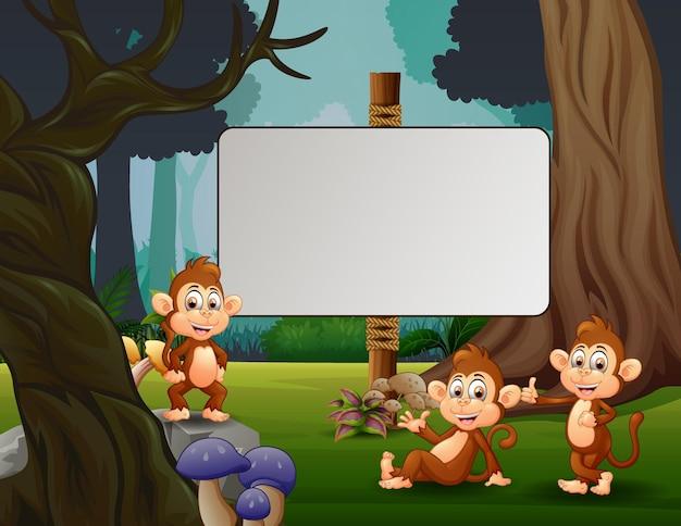 Ilustração dos desenhos animados de três macacos se divertindo no parque