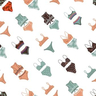 Ilustração em vetor de calcinhas e sutiãs de biquíni vintage formando um padrão uniforme para o conceito de férias de verão