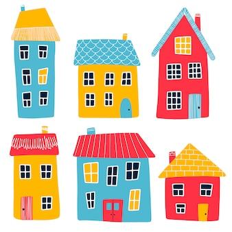 Ilustração em vetor de casas primitivas multicoloridas dos desenhos animados isoladas